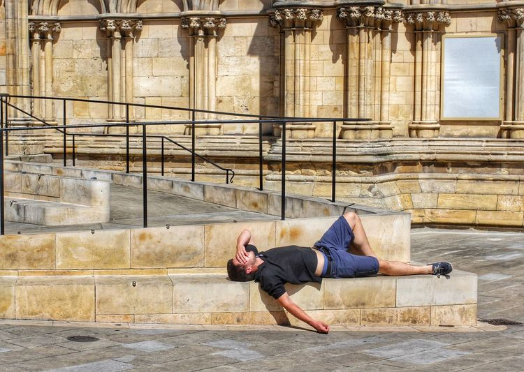 Man Laying On Stone Steps At York Minster