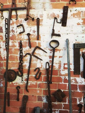 Old Tools on a brick wall 1 Architecture Brick Wall Building Built Structure Cable Day Deterioration Full Frame Low Angle View No People Old Outdoors Pipe - Tube Tools
