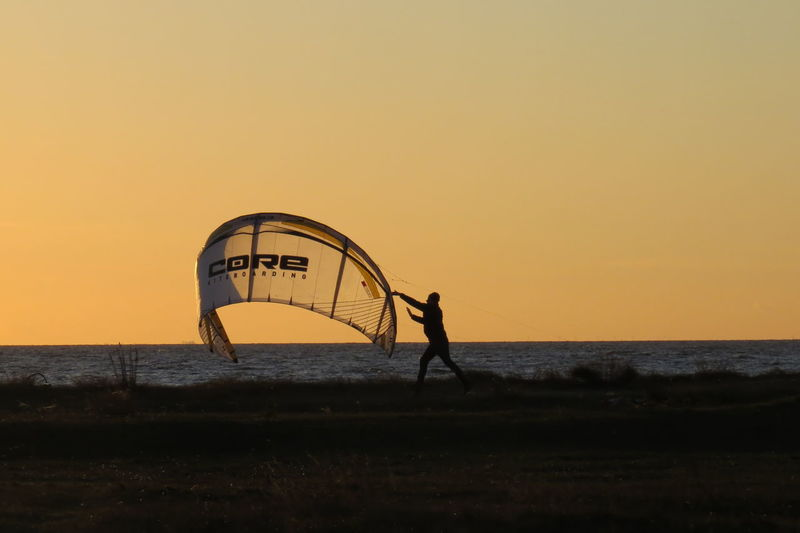 Baltic Sea Beach Kitsurfing One Person Outdoors Scenics Silhouette Sunset Water
