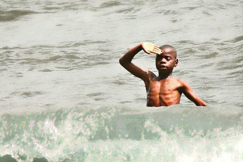 Boy playing lake rwanda africa