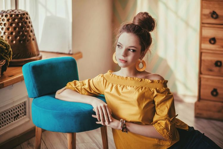 Don't look too far, right where you are - that's where I am Young And Beautiful Vintage Style Studio Shot Modeling Models Fashion Model Beauty Females Beautiful People Portrait Sitting Beautiful Woman Fashion Young Women Elégance Arts Culture And Entertainment Sofa Cozy