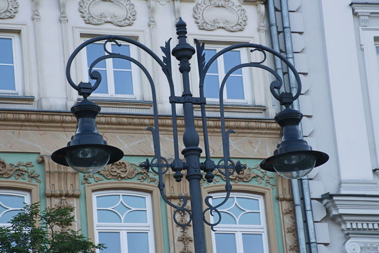 Low angle view of street light on building
