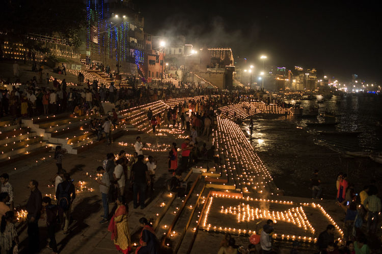 Crowd At Decorative Ghat By Ganges River During Night
