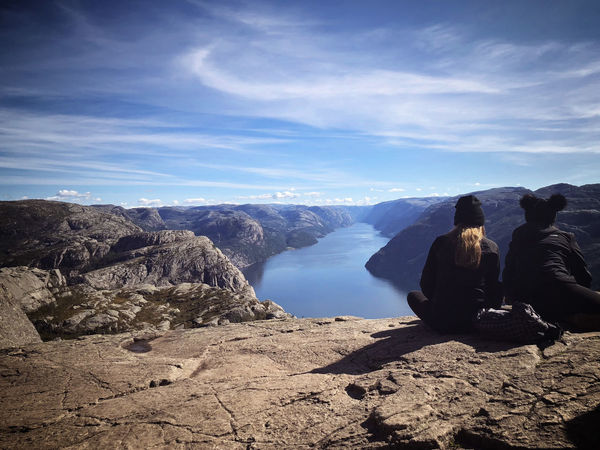 Sitting at the edge of eternity... Norway🇳🇴 Preikestolen Leisure Activity Looking At View Mountain Mountain Range Non-urban Scene Outdoors Rear View Rock - Object Scenics - Nature Sitting A New Beginning A New Beginning