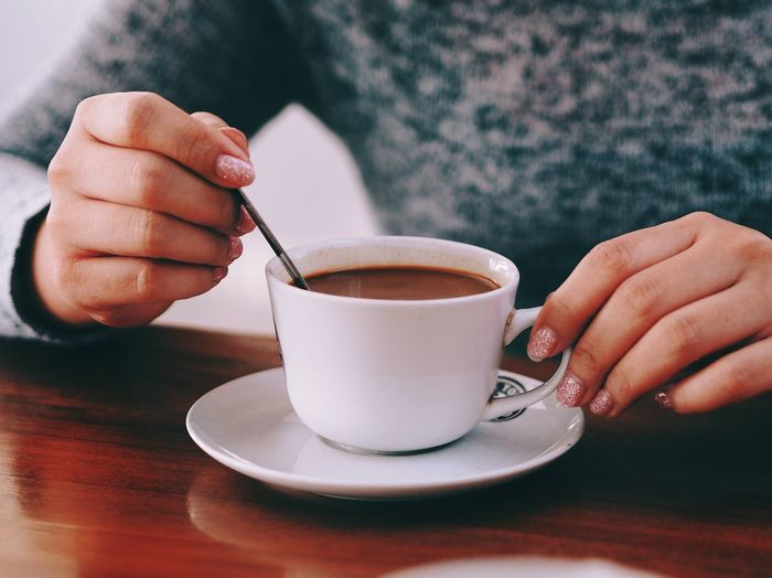 Coffee - Drink Coffee Cup Food And Drink Refreshment Drink Close-up One Person Table Saucer Holding Human Hand Cup Human Body Part Indoors  Freshness Men Heat - Temperature Real People Frothy Drink Day