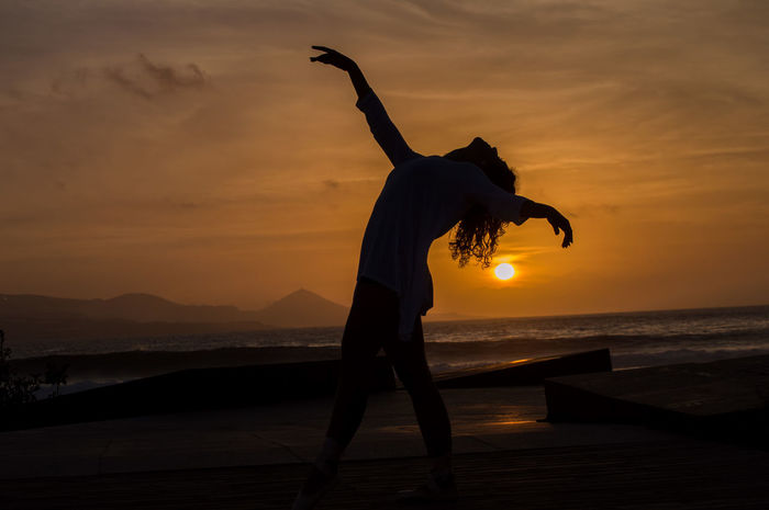 Passion Sunset Silhouette Water Nature Travel Destinations Beach Outdoors Sea Adult People One Person One Man Only Only Men Adults Only Sky Day Girl Dance Ballet Passion EyeEmNewHere Sommergefühle EyeEm Selects