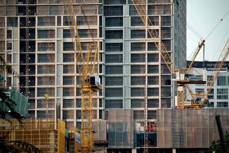 Architecture Building Exterior Built Structure City Construction Site Day Development Manual Worker Men Modern Occupation Outdoors People Progress Real People Sky Working