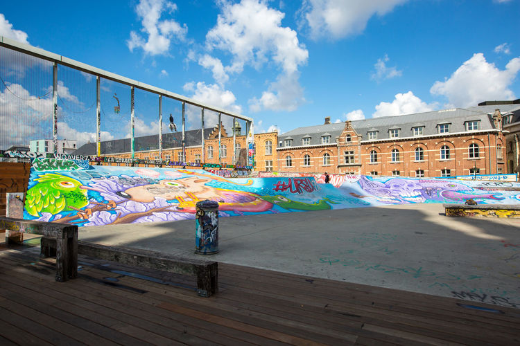 skate park in Brussels Belgium Brussels Animal Representation Architecture Art And Craft Blue Building Exterior Built Structure City Cloud - Sky Creativity Day Graffiti Multi Colored Nature No People Outdoors Rainbow Representation Skate Park Sky Travel Destinations Water