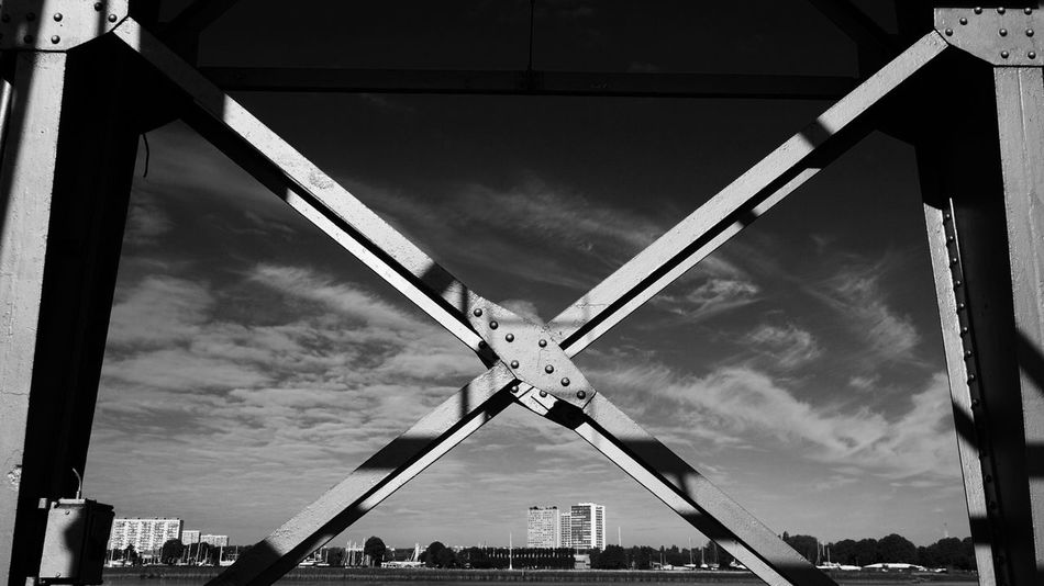 Built Structure Sky Low Angle View Cloud - Sky Architecture Day Outdoors No People Building Exterior City Windmill Urban Skyline Harbor Iron - Metal Beams Metal Beams Construction Work Black And White Metal Structure Machinery Black & White Monochrome _ Collection Monochrome Photography The Week On EyeEm
