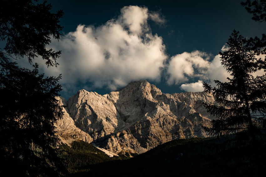 Bavaria Zugspitze Bavarian Alps Beauty In Nature Cloud - Sky Environment Formation Idyllic Land Landscape Low Angle View Mountain Mountain Peak Mountain Range Nature No People Non-urban Scene Outdoors Plant Rock Scenics - Nature Sky Tranquil Scene Tranquility Tree