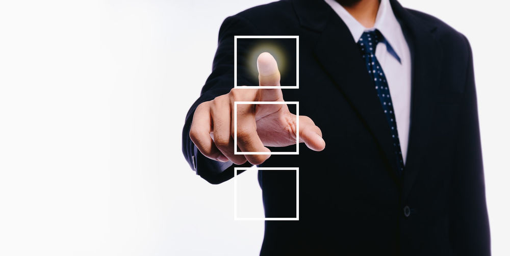 Male Businessman with Technology Communication Business Positive Press Business Business Person Businessman Choose Communication Copy Space Finger Hand Holding Intent Men One Person Screen Search Select Studio Shot Success Suit Technology Touch Screen White Background Wireless Technology