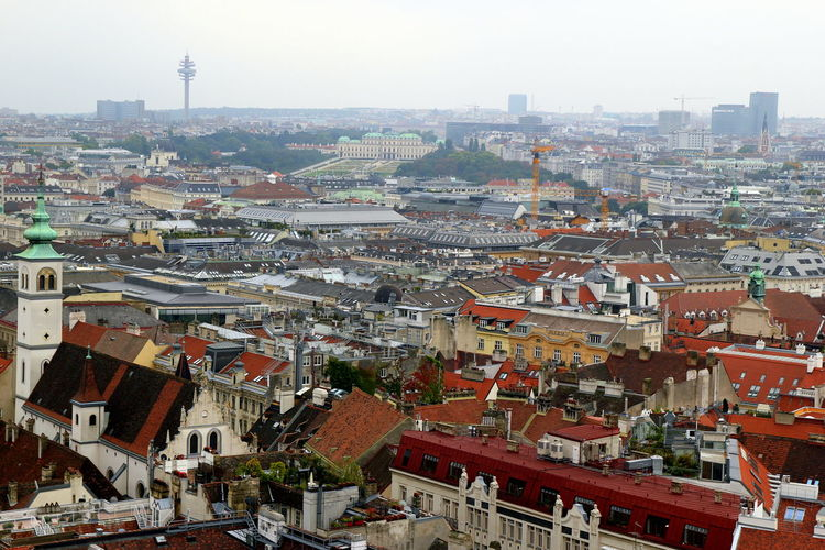 The view on the city and the roofs of houses. Vienna, Austria. Vienna Austria Travel Journey Tourism Streetphotography Street Wanderlust Architecture Building Exterior City Cityscape Outdoors Building Cloudy Overview Landmark Europe Capital Center Gothic Style Chirch Cityscape Old History