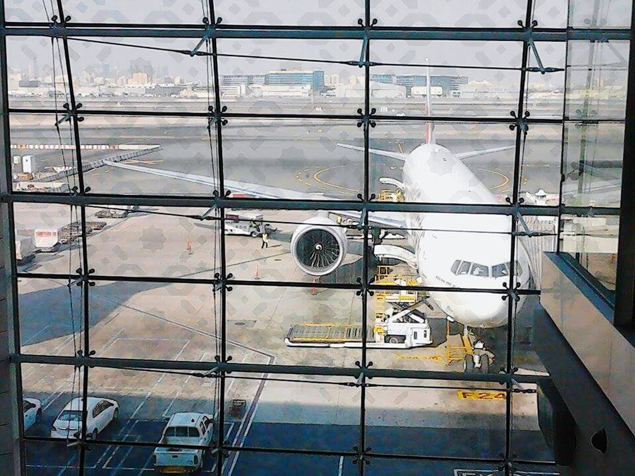 glass - material, transparent, window, indoors, reflection, built structure, architecture, glass, building exterior, city, building, day, modern, no people, low angle view, full frame, geometric shape, backgrounds, ceiling, airport