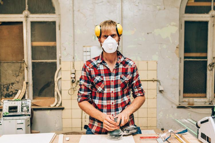 Full length portrait of man working