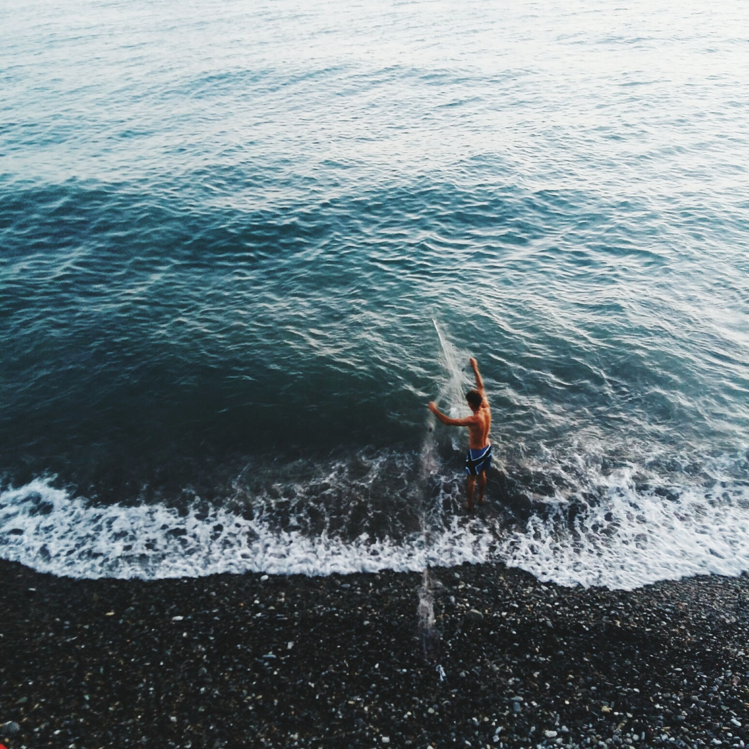 sea, water, lifestyles, real people, leisure activity, one person, adventure, waterfront, day, men, outdoors, nautical vessel, extreme sports, nature, beauty in nature, wave, scenics, wake - water, people