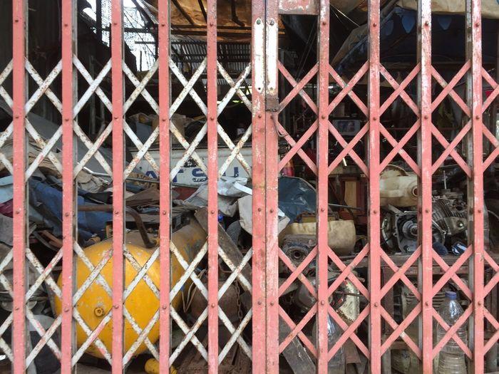 Full frame shot of metal fence against building