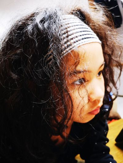 Close-up portrait of a girl looking down