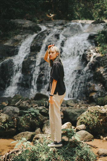 Full length of woman standing on rock
