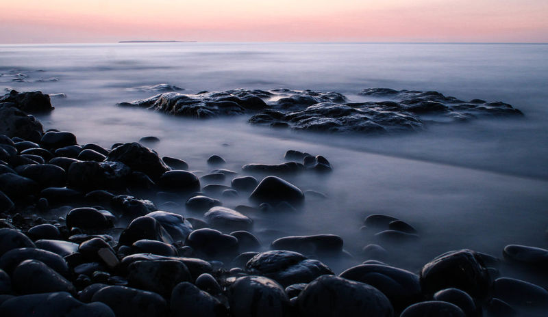 Travels around Devon. A wonderful part of the country. Pebble Beach Sunset_collection Beauty In Nature Horizon Over Water Long Exposure Nature No People Pebble Rock Scenics - Nature Sea Seascape Seaside Seaside_collection Sky Solid Tranquility Water My Best Travel Photo