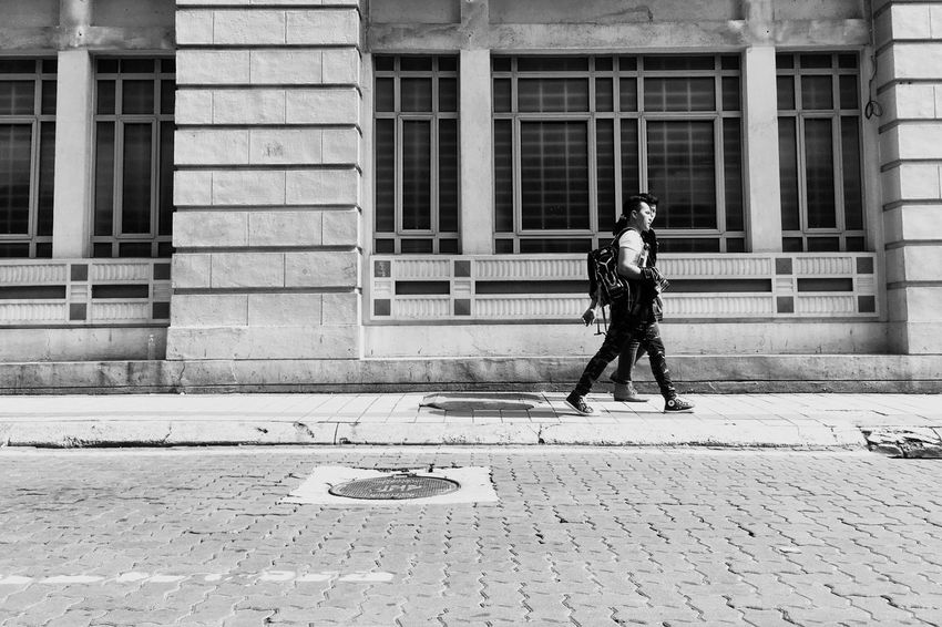 EyeEm Selects Walking Around The City  Walking Around Two People Two Is Better Than One Bromance Menstyle Men Walking Blackandwhite Building Exterior Real People Architecture One Person Outdoors Built Structure Full Length Day Men Lifestyles Military Adult City Adults Only One Man Only People two men walking