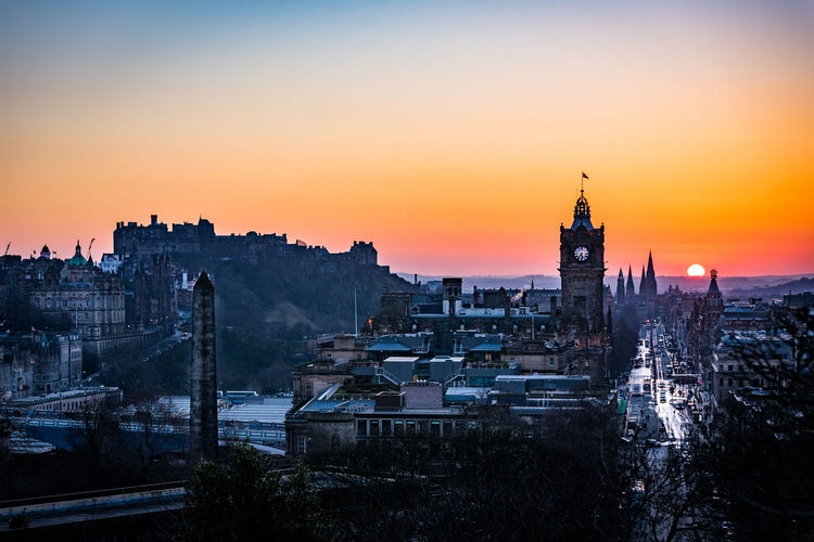 Winter sunset in Edinburgh, Scotland. Balmoral Hotel City Cityscape Edinburgh Edinburgh Castle Edinburgh, Scotland Orange Sky Princes Street Travel Architecture Built Structure City Cityscape Dusk No People Outdoors Sunset Tourism Travel Destinations Urban Skyline