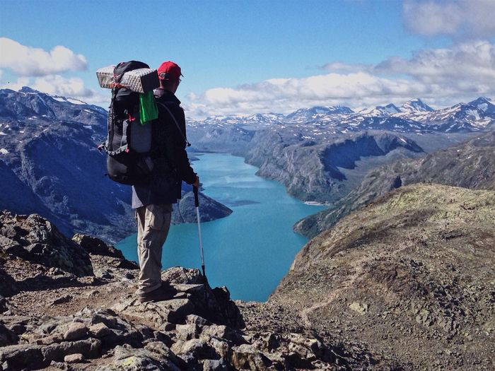 Hiker on the Besseggen Ridge, Jotunheimen national park, Norway Mountain Adventure Backpack Real People Leisure Activity Hiking Nature Lifestyles Mountain Range Full Length Day Rock - Object Beauty In Nature Outdoors One Person Jotunheimen Norway Besseggen Scenics