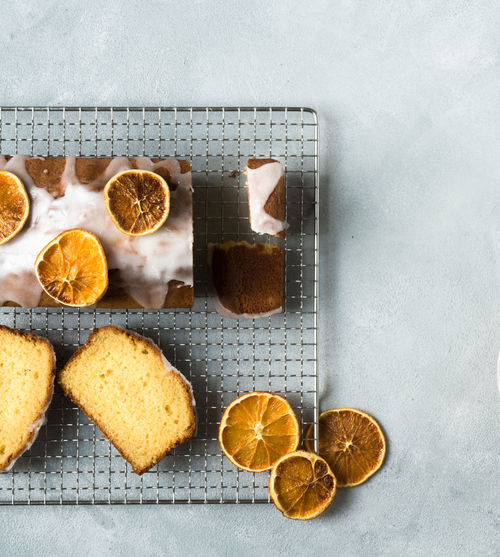 orange cake and orange cake slices with dried orangeslices beautiful placed on a bright grey surface from above | daylight foodphotography Dessert From Above  Homemade Homemade Food Nikon Baked Bright Surface Cake Citrus Fruit Daylight Photography Directly Above Food Food Photography Foodphotography Freshness High Angle View Indoors  Light And Shadow No People Orange Slices Still Life
