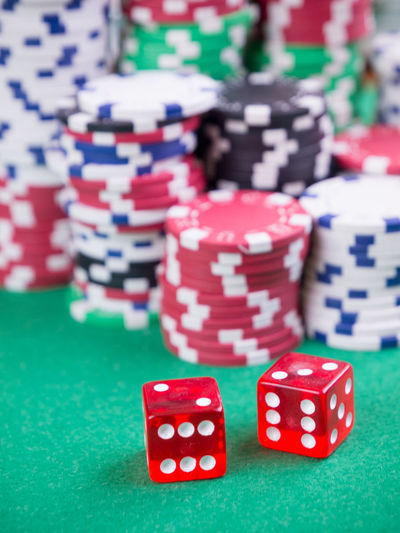 poker cards and casino cheaps Arts Culture And Entertainment Casino Close-up Dice Focus On Foreground Gambling Gambling Chip Game Of Chance Green Color Indoors  Large Group Of Objects Leisure Activity Leisure Games Luck Nightlife No People Opportunity Pattern Red Relaxation Stack Table