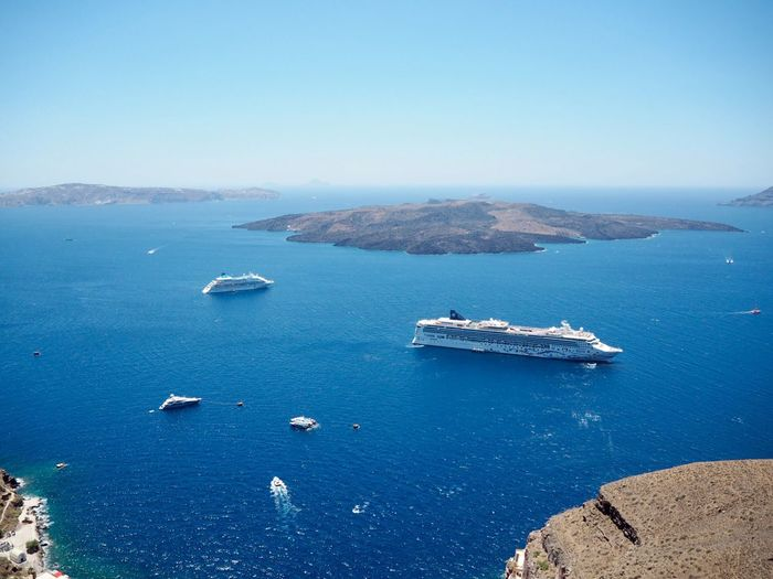 View from Fira, Santorini EyeEm Selects Water Sea Nautical Vessel Transportation Scenics - Nature Beauty In Nature Mode Of Transportation Blue Sky Nature Tranquil Scene Tranquility High Angle View Travel No People Day Ship Land Clear Sky Outdoors
