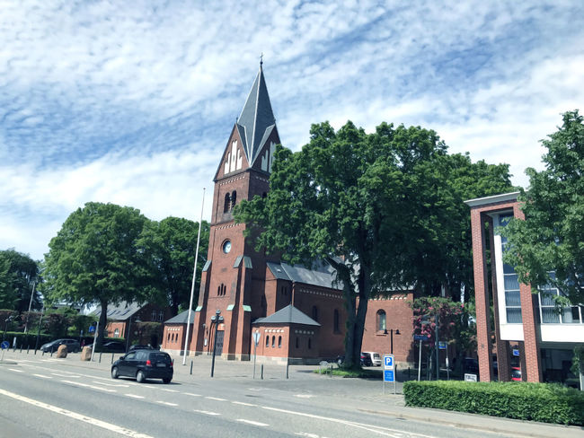 Travel to Europe under summer,church in the Herning Architecture Beauty Building Exterior Built Structure Car Church Cloud - Sky Colorful Day Denmark Europe Herning Nature No People Outdoors Place Of Worship Religion Road Scandinavia Skies Sky Transportation Travel Tree Urban