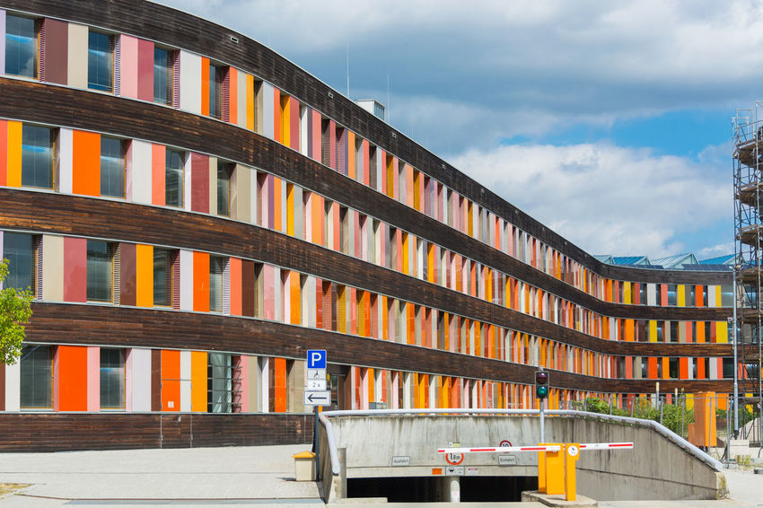 Environment and colorful facade of the Federal Environment Agency in Dessau Cloud - Sky Architecture Built Structure Sky No People Building Exterior Nature Day Railing Table Seat Building Outdoors Chair City In A Row Multi Colored Absence Book Wood - Material
