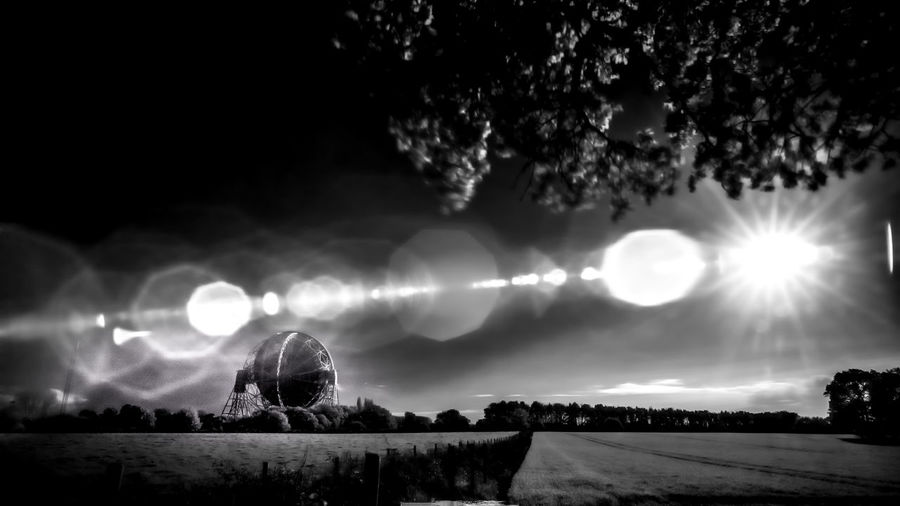 """This isn't a war,"" said the artilleryman. Black And White Photography Blackandwhite Photography Landscape_photography Lens Flare Lensflare Monochrome Photography Nature No People Outdoors Radio Astronomy Radio Astronomy Observatory Radio Telescope Sky Sun Telescope"