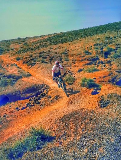 Leisure Activity Real People One Person Rear View Outdoors Day Landscape Adventure Lifestyles Full Length Scenics Nature Sky Beauty In Nature People Mountain Biking Mountain Bike Offroad
