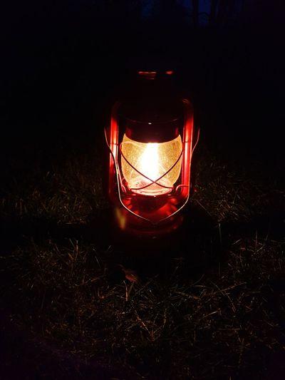Close-up of illuminated lantern on field