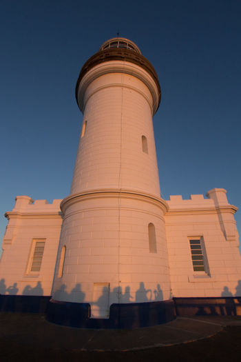 Sunrise at Byron Bay Lighthouse Byron Bay Byron Bay Lighthouse Lighthouse Architecture Blue Built Structure Clear Sky Low Angle View Nature Shadow Shadows Sky Sunrise Tall - High Tourism Tower Travel Travel Destinations