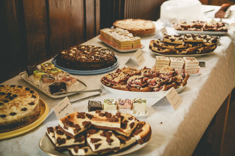 High angle view of various sweet food arranged on table in buffet