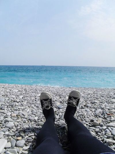 Sea Horizon Over Water Water Beach Low Section Scenics Shore Nature Beauty In Nature Sky Human Leg Tranquility Day Pebble One Person Outdoors Human Body Part Real People Pebble Beach Feet By The Sea Nice, France Out Of The Box