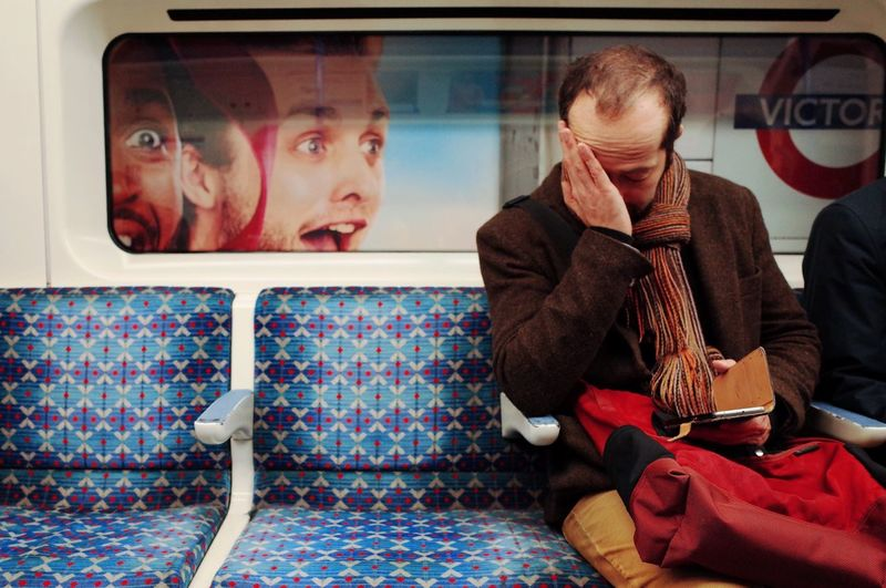 Indoors  Tube Man Advertising Funny London Tiredness Lifestyles Street Photography Ironic  Victoria Line Commuting Joy Tired Man