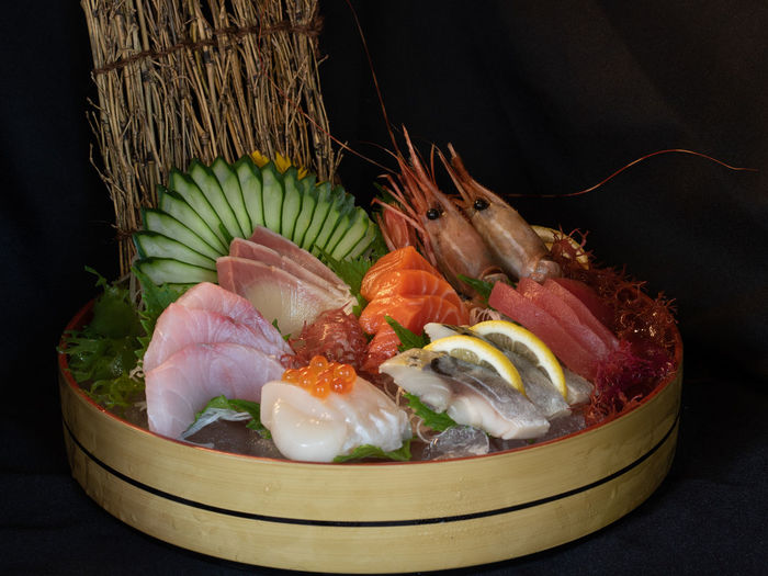 Close-up of fish and vegetables on table