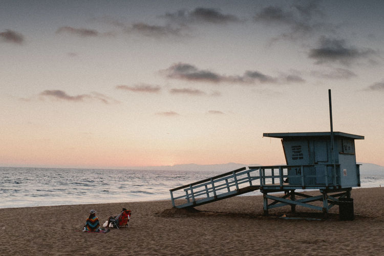 Architecture Beach Beauty In Nature Cloud - Sky Day Horizon Over Water Human Body Part Lifeguard Hut Nature Outdoors People Postcard Sand Scenics Sea Sky Sunset Tranquility Vacations Water