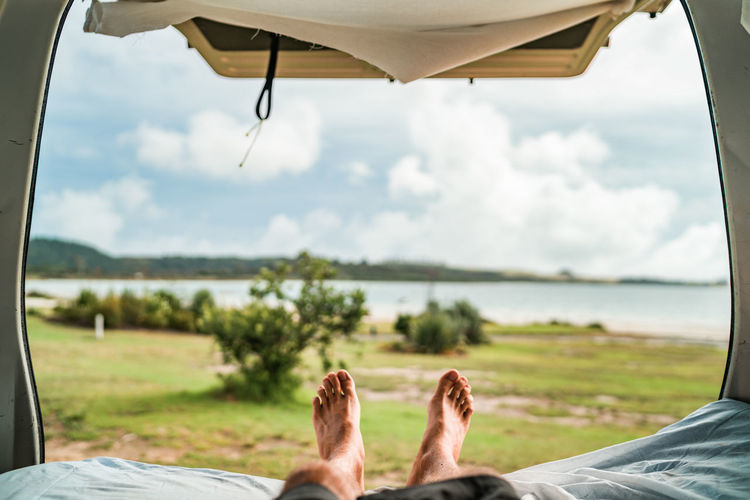Adult barefoot Close-up Comfortable Day Focus On Foreground Human Body Part Human Foot Human Leg Leisure Activity Low Section Lying Down Men Nature One Person Outdoors People Real People Relaxation Sky Vacations Vanlife Water