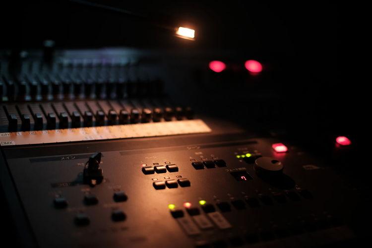 Close-up of amplifier in darkroom