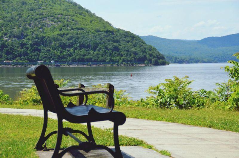 Empty Bench Overlooking Calm Lake