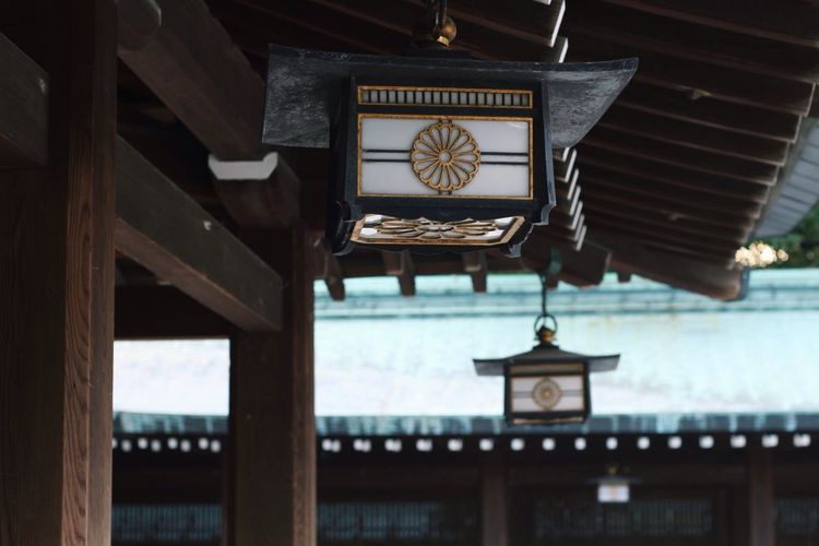 Low Angle View Of Lanterns Hanging From Roof At Meiji-Jingu Shrine