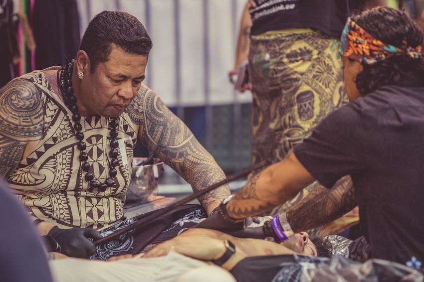 London Tattoo Convention Male Adult Working Occupation Hobby Skin Ink People Focused Real People Sitting Men Lifestyles Indoors  Customer  Human Hand Day Tobacco Dock Arts Culture And Entertainment EyeEm Selects Authentic