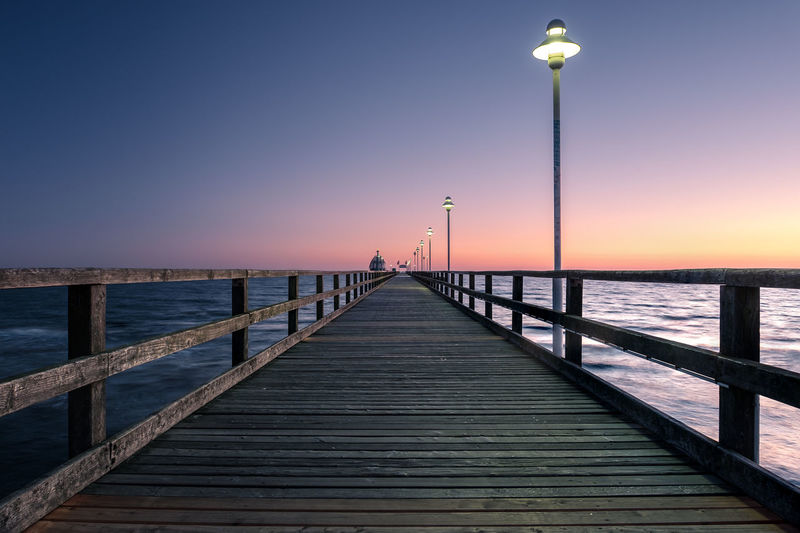 Beach Beauty In Nature Clear Sky Day Horizon Over Water Jetty Nature No People Outdoors Pier Railing Scenics Sea Sky Sunset Tranquil Scene Tranquility Water Wood - Material Wood Paneling