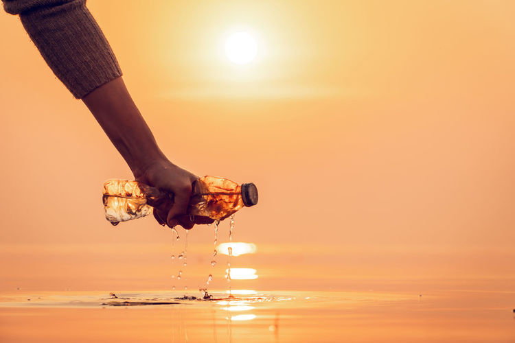Water Nature Sunset Sun Sunlight Body Part Hand Holding Glass Garbage Plastic