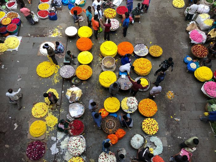High angle view of people at flower market