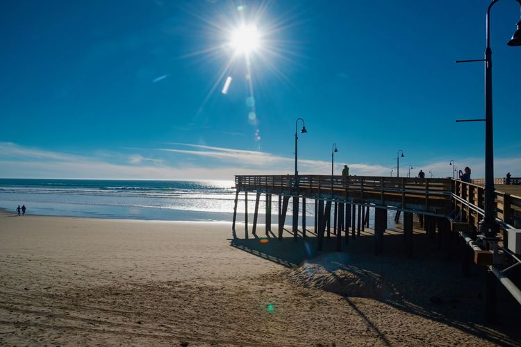 Sky Water Sea Beach Sun Land Sunlight Nature Horizon Over Water Lens Flare Sunbeam Horizon Beauty In Nature Tranquility Scenics - Nature Tranquil Scene Day Sand Built Structure No People Outdoors Bright