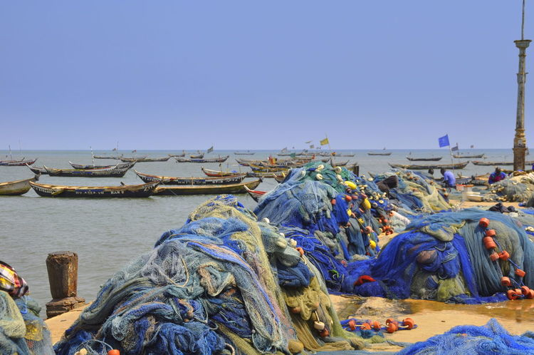 Fishing Equipment Ghana Pier Traditional Culture Africa African Tree Beach Blue Clear Sky Commercial Fishing Net Copy Space Drying In The Sun Fishing Fishing Boat Fishing Industry Fishing Net Nature Nautical Vessel No People Pirogue Sea Stack Transportation Water